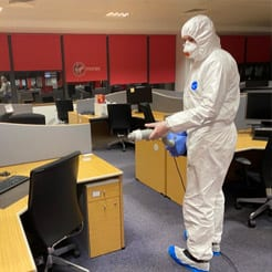Contego technician disinfecting an office space.